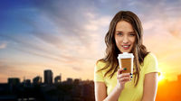 young woman or teenage girl drinking coffee