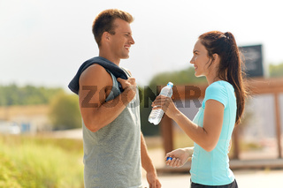 couple with bottle of water after doing sports