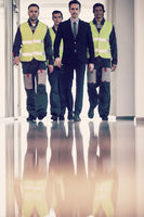 Workers moving along the corridor