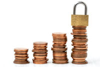Golden padlock on the stack of coins