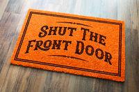 Shut The Front Door Halloween Orange Welcome Mat On Wood Floor Background