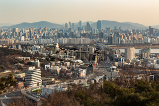 SEOUL, SOUTH KOREA - JAN 22, 2018: Aerial shot of Seoul skyline from Namsan Park with highway at sunset
