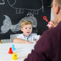 Cute little toddler boy at child therapy session.