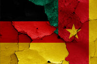 flags of Germany and Cameroon painted on cracked wall