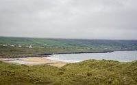 The burren with fog at dunes of fanore beach