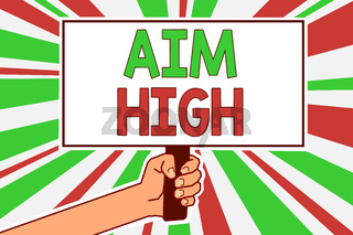 Text sign showing Aim High. Conceptual photo go for best job school or activity Asking someone to dream big Man hand holding poster important protest message green red rays background.