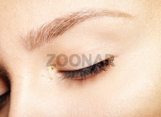 Female closed eyes. Closeup macro beauty portrait of young woman face