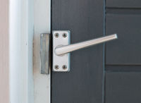 Close up view of aluminum door window handle