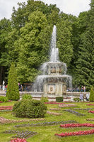 People visiting famous landmark of Peterhof, close to city of St. Petersburg in Russia and enjoying sunny summer day
