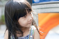 Asian girl playing in playground.