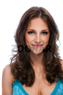 Portrait of young smiling beautiful woman with dark hair in blue dress