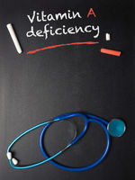 The words Vitamin A deficiency on a chalkboard