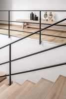 Stylish interior in modern style with wooden stair