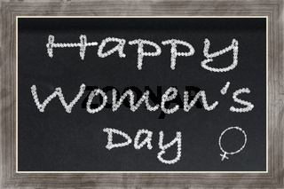 Chalkboard with text Happy Women's Day