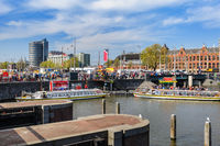 Sightseeng at Canal Boats near the Central Station of Amsterdam