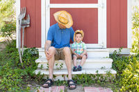 Playful Young Caucasian Father and Mixed Race Chinese Son Wearing Cowboy Hats