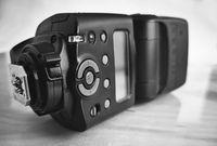Camera accessories: modern on-camera flash. Presented close-up.