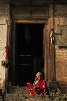 PUNE, MAHARASHTRA, INDIA, February 2019, Old woman sitting front of home