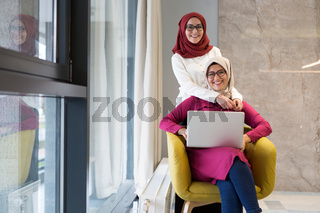 Women working together, office interior