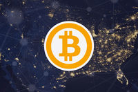 Logo bitcoin over night map of the United States. crypto currency symbol