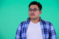 Face of young overweight Asian hipster man thinking