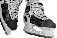 Men's skates on a white background, close-up.