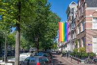 Rainbow flag LGBT community on building in Amsterdam, the Netherlands