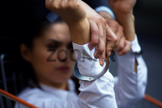young woman in handcuffs