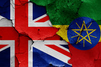 flags of UK and Ethiopia painted on cracked wall