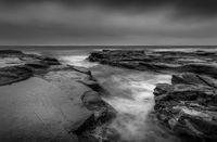Moody seascape ocean rock channel