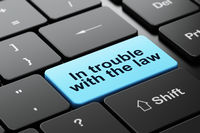 Law concept: In trouble With The law on computer keyboard background