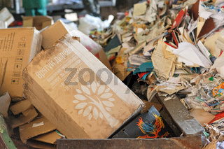 Piles of old cardboard boxes stored for recycling. Closeup