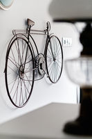 Bicycle hanging on white wall room interior