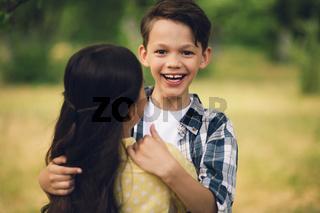 Little kids hugging.