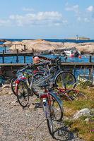 Bicycles by a sea bay with boats