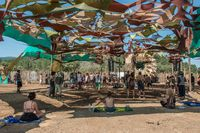 Attendees and atmosphere in the Lost Theory psytransce music festival held in Riomalo de Abajo