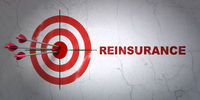 Insurance concept: target and Reinsurance on wall background