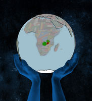 Zambia on political globe in hands