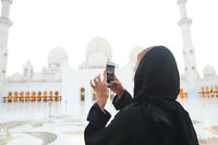 Woman taking picture of Sheikh Zayed Grand Mosque