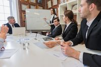 Business woman presenting teamwork concept