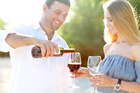 Happy Woman and man couple drinking red wine