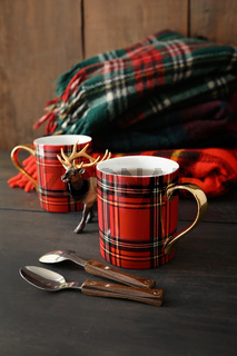 Mugs with hot tea on wood table