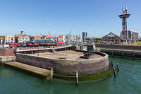 Mole in historic harbor Dutch Vlissingen with restaurant and terrace