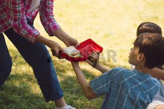 Teacher giving snack to kids