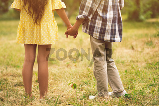 Boy and girl holding hands.