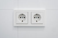 double socket, new electric plug on white tiles