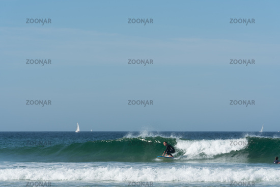 surfing on the west coast of Brittany in France at Toulinguet Beach near Camaret-Sur-Mer