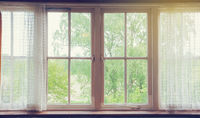 Window with curtains and green nature view , vintage design