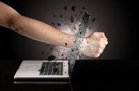 Hand breaks laptop glasses