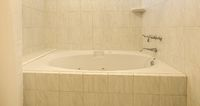 Bath tub with warm white tile